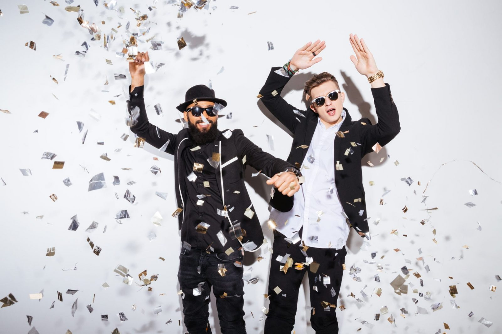 two guys celebrating with confetti