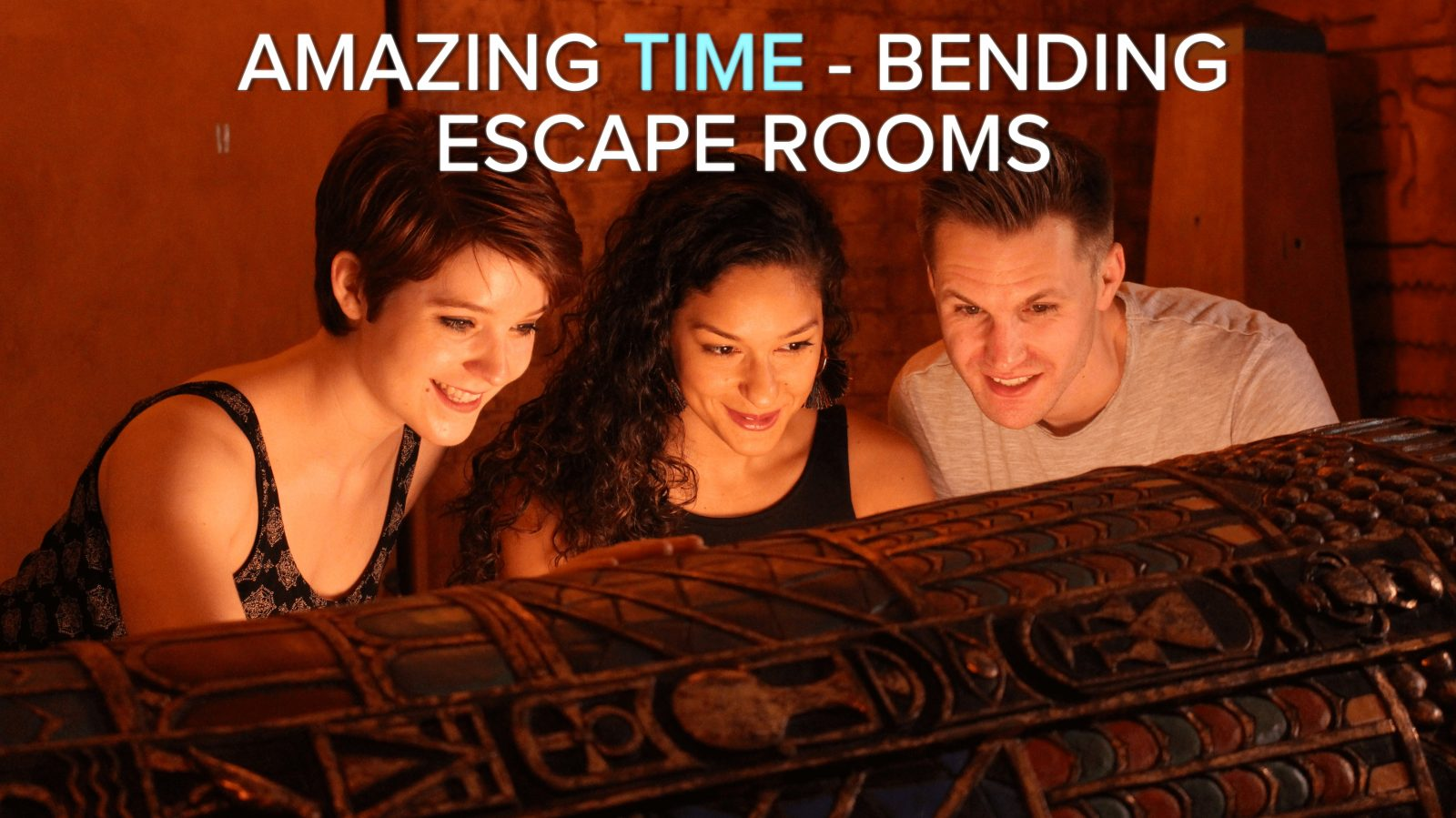 three players in the egyptian tomb escape room look into a sarcophagus
