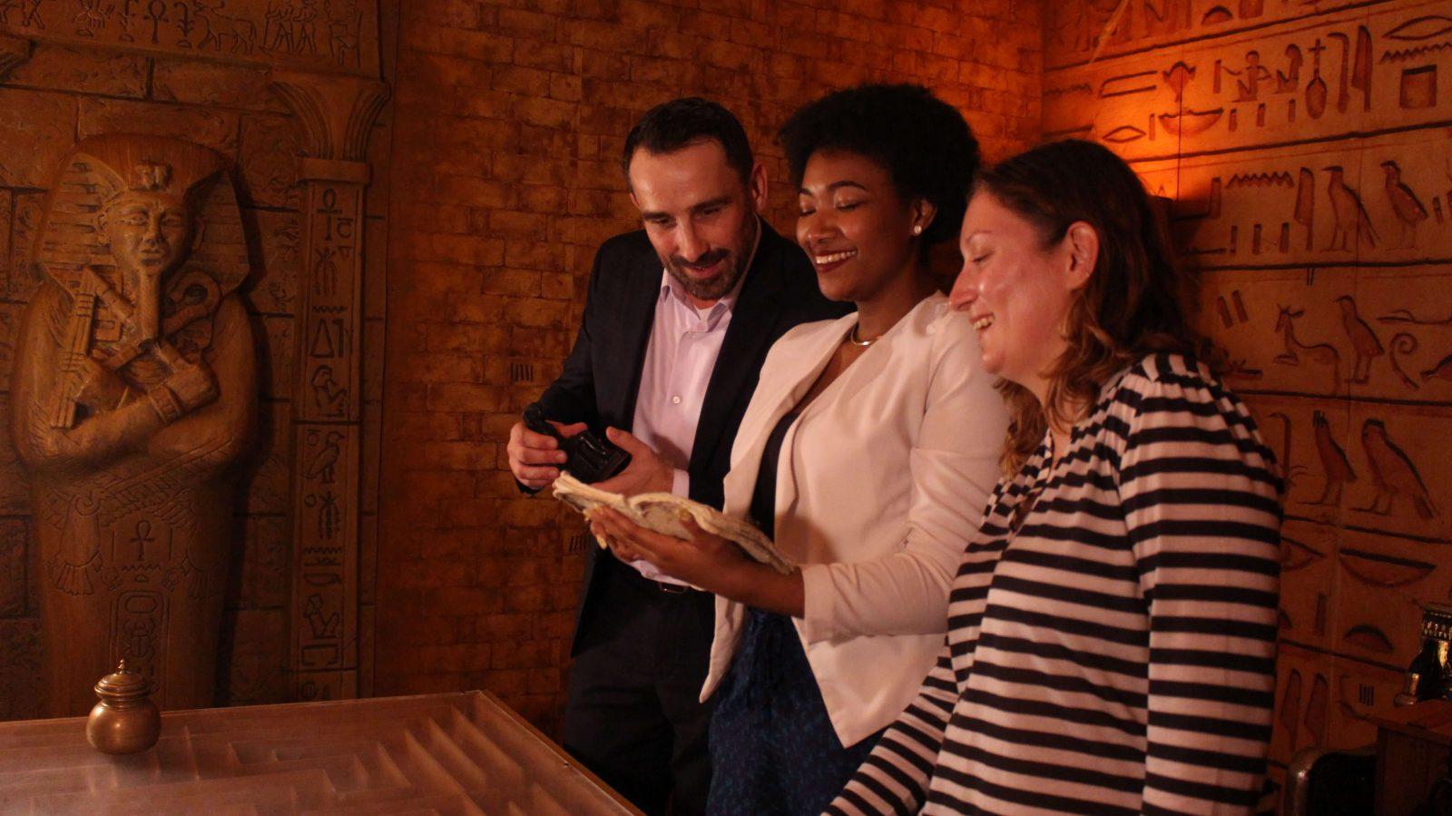 coworkers read a clue in the egyptian escape room