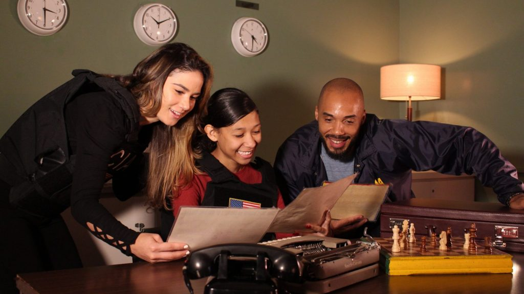 friends playing the lost spy escape room