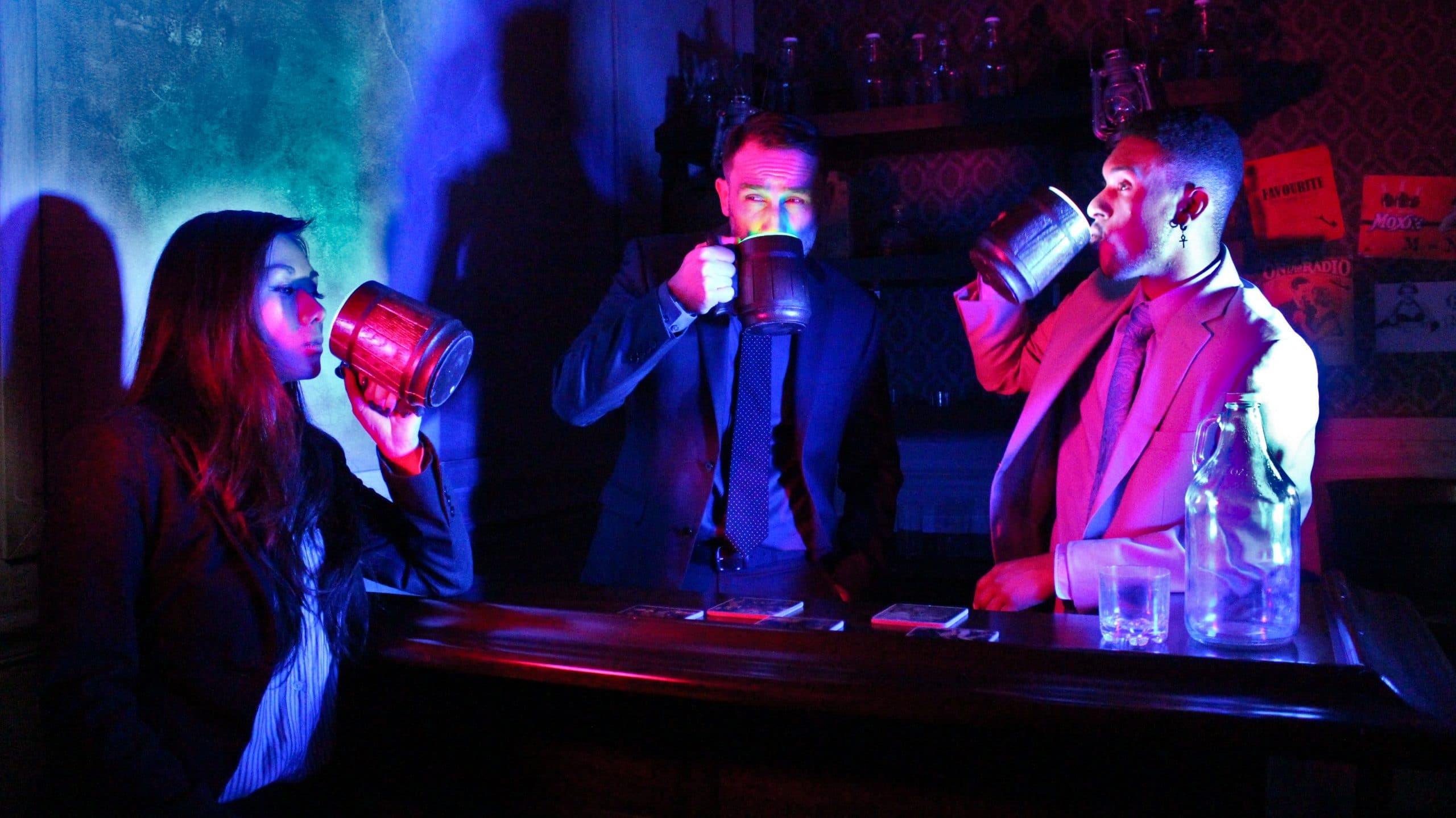 three players drinking something at the speakeasy escape game