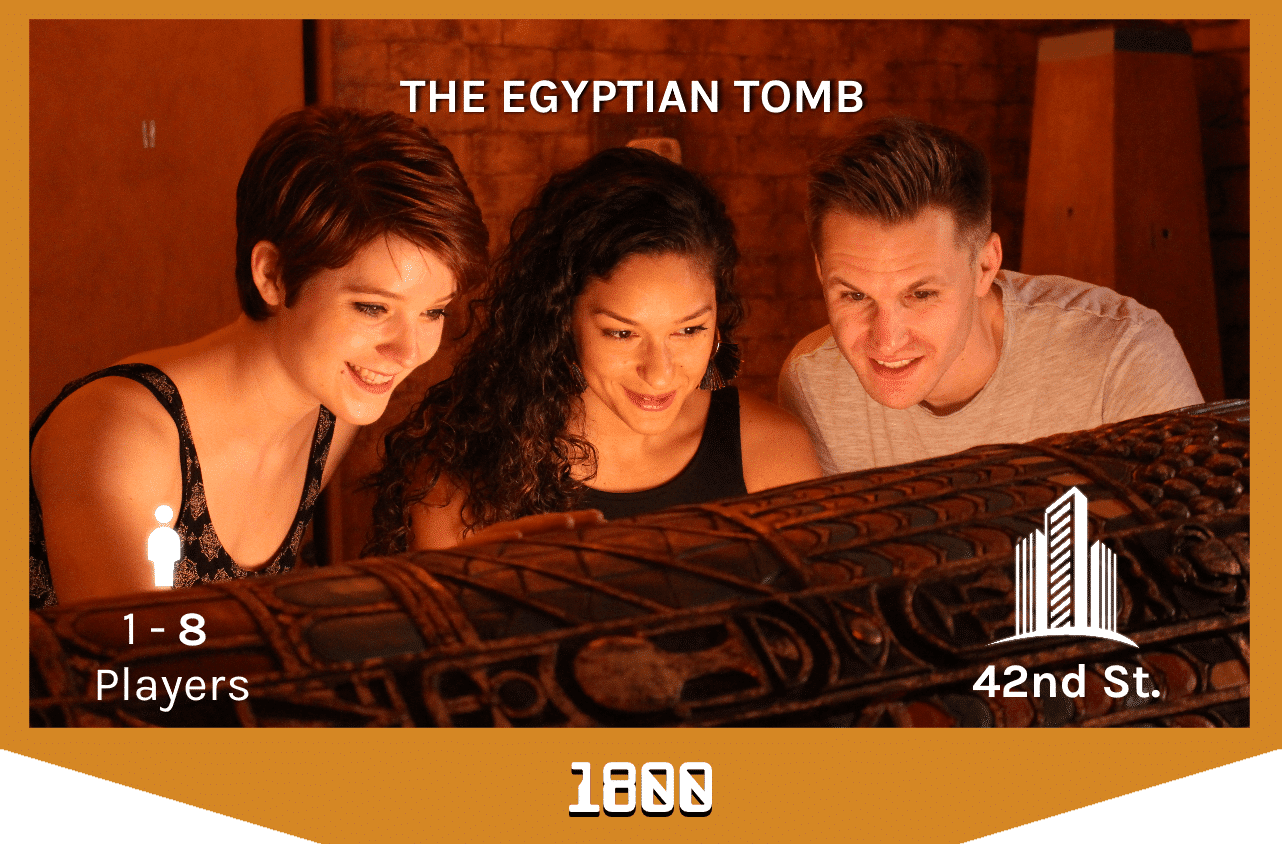 players looking into the sarcophagus in the egyptian tomb escape room, 1-8 players, 42nd street.